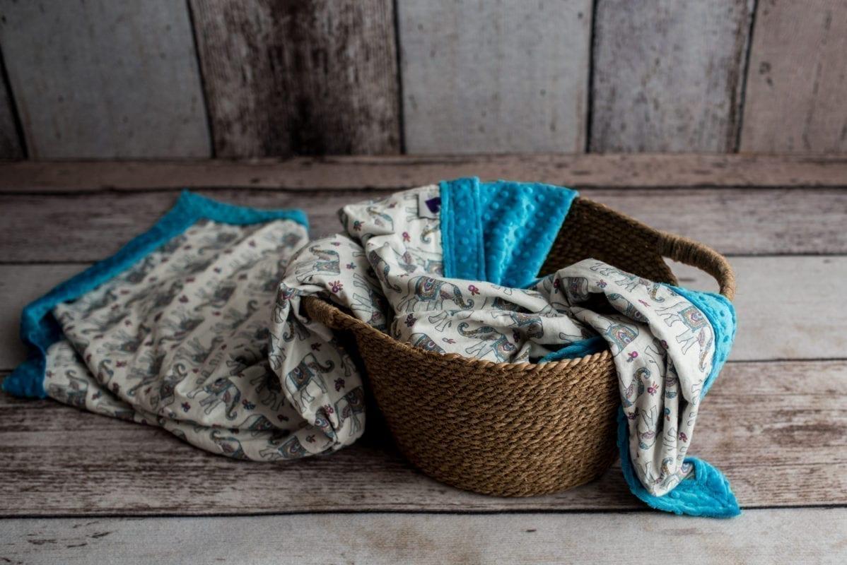 Teal/Elephant luxury weighted blanket in basket